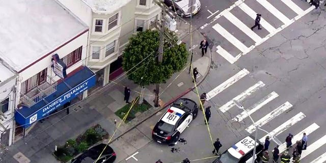 Police cordon off the scene of a shooting that left an officer and a suspect wounded with non-life threatening injuries in the city's Mission District on Wednesday.