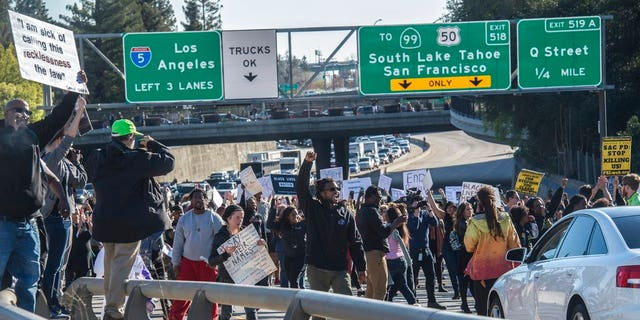Hundreds of protesters march in Sacramento, Calif., disrupting rush hour traffic, to protest a police fatal shooting of an unarmed black man.