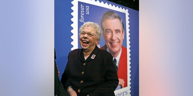 Fred Rogers wife, Joanne Rogers, shares a laugh with friends in front of a giant Mister Rogers Forever Stamp following the first-day-of-issue dedication in WQED's Fred Rogers Studio in Pittsburgh on Friday.