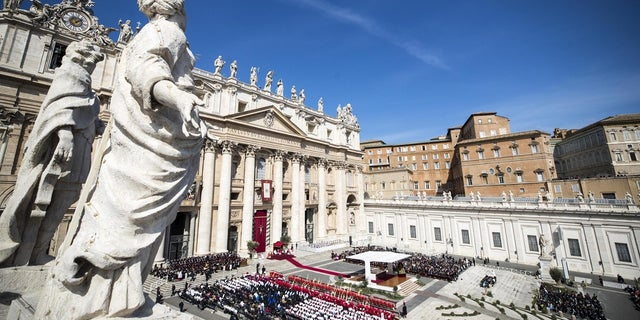 A view of St. Peter's Square filled with faithful as Pope Francis celebrates a Palm Sunday Mass, at the Vatican. (AP Photo/Andrew Medichini)