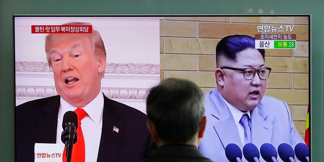 A man watches a TV screen showing file images of U.S. President Donald Trump, left, and North Korean leader Kim Jong Un, right, during a news program at the Seoul Railway Station in Seoul, South Korea, Tuesday, March 27, 2018.