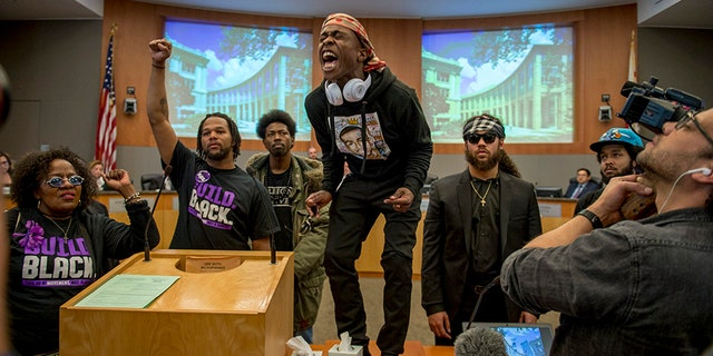 Stevante Clark, along with other demonstrators, attended the Sacramento City Council meeting Tuesday night, which opened with a moment of silence for his 22-year-old brother killed by police.