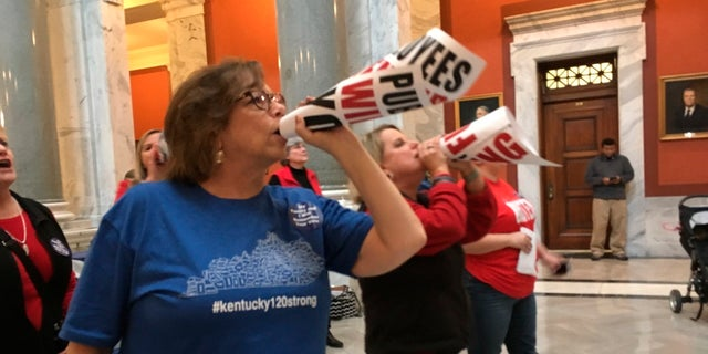"""Retired teacher Lydia Coffey chants """"Vote them out"""" as lawmakers in Kentucky debate a bill to make changes to the state's pension system, March 29, 2018, in Frankfort, Ky."""