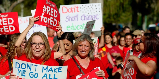 Arizona teachers and education advocates march at the state Capitol in March 2018.
