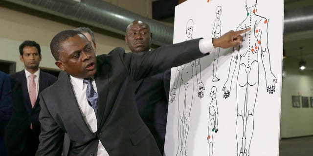 Dr. Bennet Omalu explains how police shooting victim Stephon Clark was struck by bullets, during a news conference in Sacramento, Calif., March 30, 2018.