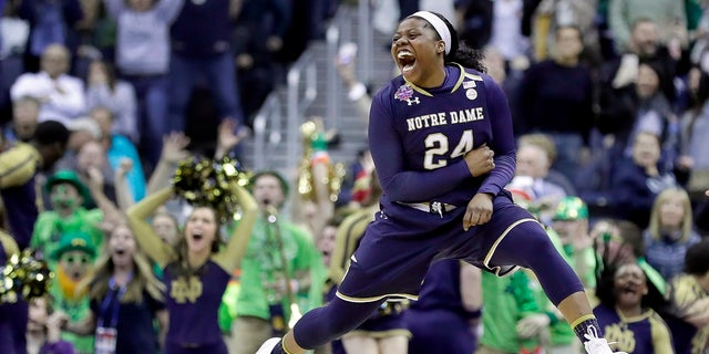 Notre Dame's Arike Ogunbowale celebrates after making the game-winning basket during overtime against Connecticut in the semifinals of the women's NCAA Final Four college basketball tournament, Friday, March 30, 2018, in Columbus, Ohio. Notre Dame won 91-89.