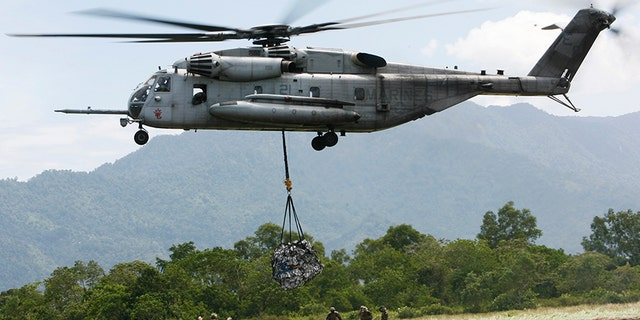 In this Saturday Oct. 10, 2009, file photo, a U.S. military helicopter, the CH-53E Super Stallion, airlifts humanitarian aid to be dropped in affected regions around Pariaman, north of Padang, Indonesia. On Tuesday, April 3, a CH-53E Super Stallion similar to the one shown went down during a training mission near El Centro, Calif., a few miles from the U.S.-Mexico border.