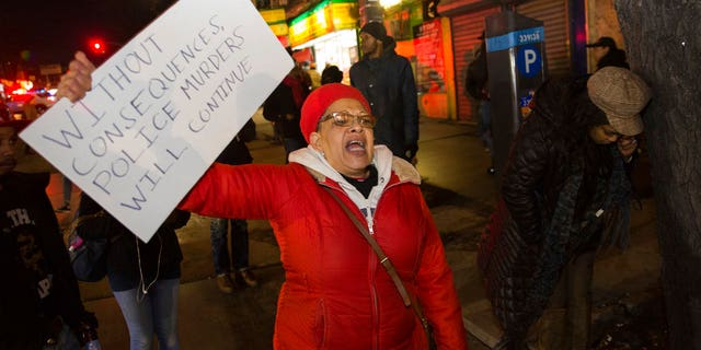 Protesters suggested the police shooting of a pipe-wielding Brooklyn man this week was murder.