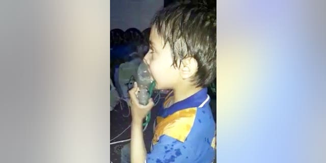 This image made from video released by the Syrian Civil Defense White Helmets shows a toddler given oxygen through respirators following an alleged poison gas attack.