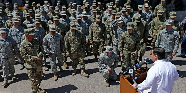 Arizona Gov. Doug Ducey speaks to Arizona National Guard soldiers prior to deployment to the Mexico border on April 9, 2018.