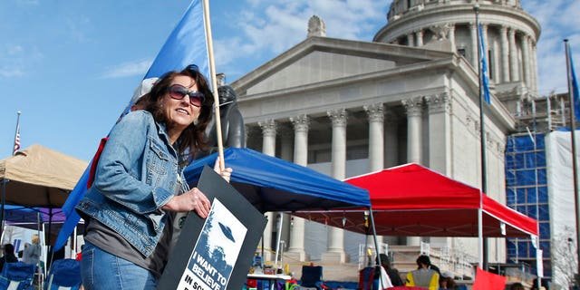 Leaders of Oklahoma's largest teacher's union have demanded a repeal of a capital gains tax exemption and for the governor to veto a repeal of a proposed lodging tax as they push for more education funding in massive demonstrations at the state Capitol, Tuesday, April 10, 2018, in Oklahoma City.
