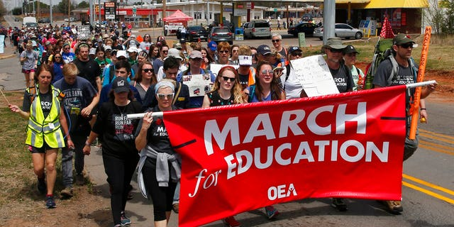 Demonstrators in Oklahoma on the final leg of a 110-mile trip from Tulsa to the state Capitol as protests continue over school funding, in Oklahoma City, Tuesday, April 10, 2018.