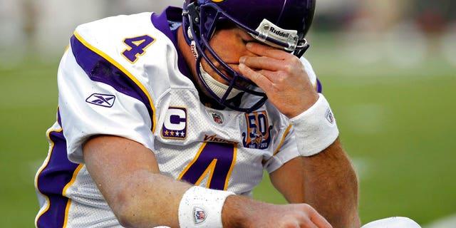 FILE 2010: Minnesota Vikings quarterback Brett Favre rubs his eyes after being hit by New England Patriots linebacker in Foxborough, Mass.