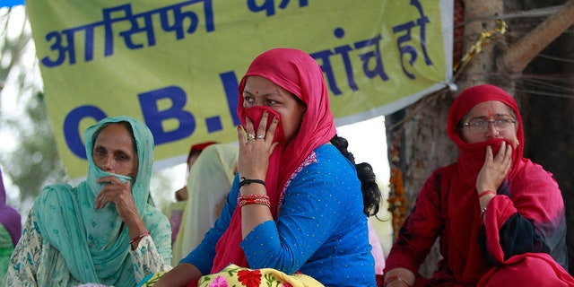 Village women sit on a hunger strike demanding that the investigation into the rape and murder of 8-year-old girl Asifa be handed over to the Central Bureau of Investigation (CBI), claiming that the six Hindu men accused in the attack had been framed and that the police investigation was flawed, in Kathua, India.