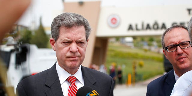 Samuel Brownback, US Ambassador-at-Large for International Religious Freedom, talks to members of the media outside the prison complex Aliaga, Izmir province, western Turkey, where jailed pastor Andrew Craig Brunson appeared on his trial at a court inside the complex