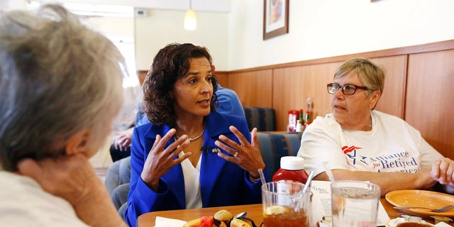 In this photo, Dr. Hiral Tipirneni talks with supporters at a local restaurant in Sun City, Arizona.