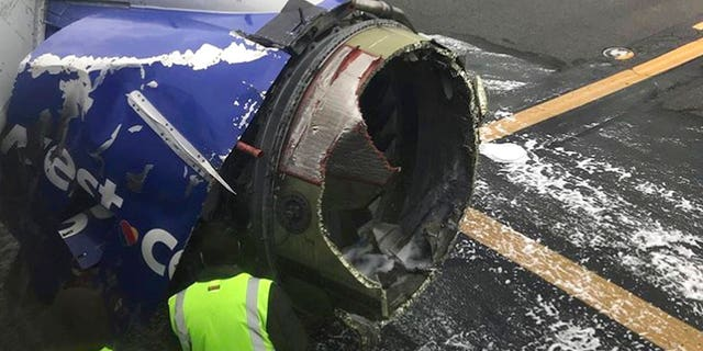 The jet engine casing of a Southwest Airlines airplane that blew apart mid-flight, killing a passenger.