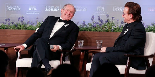 Former President George W. Bush, left, and U2 musician Bono participate in a Q&A session during a gala for the Forum on Leadership at the George W. Bush Institute, Thursday, April 19, 2018, in Dallas.