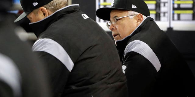 Chicago White Sox manager Rick Renteria, right, talks with pitching coach Don Cooper in the dugout during Saturday night's game against the Houston Astros.