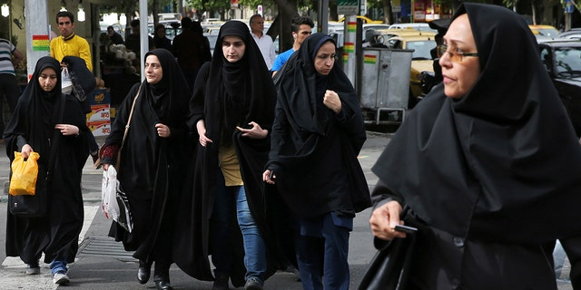 A grainy video of female officers from Iran's morality police assaulting a young woman whose headscarf only loosely covered her hair has sparked a new public debate on the decades-long requirement for women in the Islamic Republic.