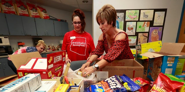 While teachers are on strike, many, including those pictured here, have donated food or worked with charities to ensure students can still receive a meal even while school isn't in session.