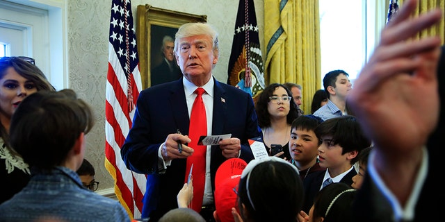 President Trump signed hats and press credentials for the kids.