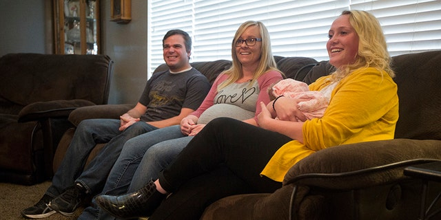 From left to right, Wendell and Laura Creager and Morlie Hayes, seen holding newborn baby, Kayla.