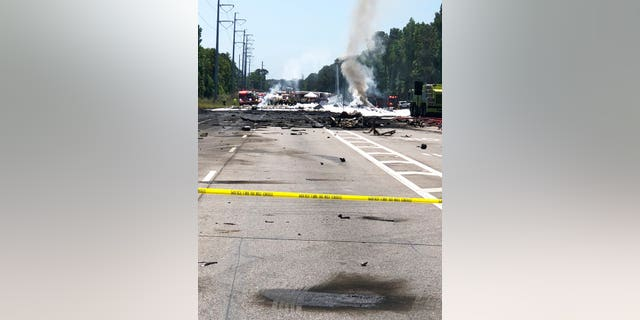 Emergency personnel work at the scene of an Air National Guard WC-130 cargo plane that crashed near Savannah, Ga., Wednesday, May 2, 2018.