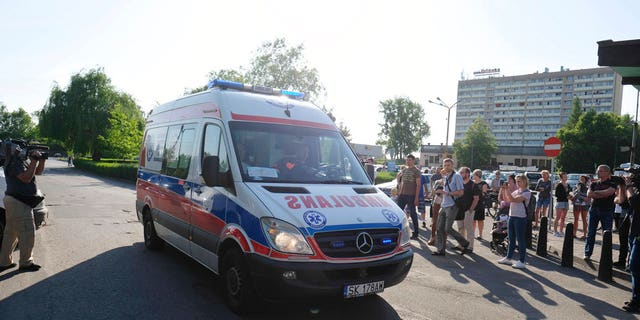 An ambulance arrives after an earthquake at the Zofiowka coal mind in Jastrzebie-Zdroj in southern Poland.