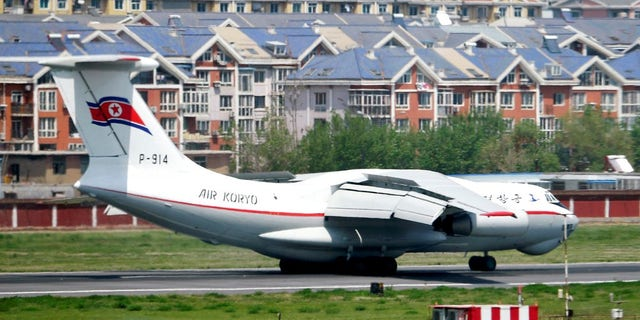 A North Korea's Air Koryo plane lands in an airport in Dalian, China, Tuesday, May 8, 2018.