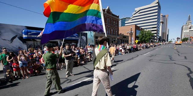 In this July 8, 2014 photo, a group of Boy Scouts march during the Salt Lake City's annual gay pride parade in Salt Lake City, Utah.