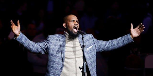R. Kelly performs the national anthem at an NBA game in Brooklyn, N.Y., Nov. 17, 2015.