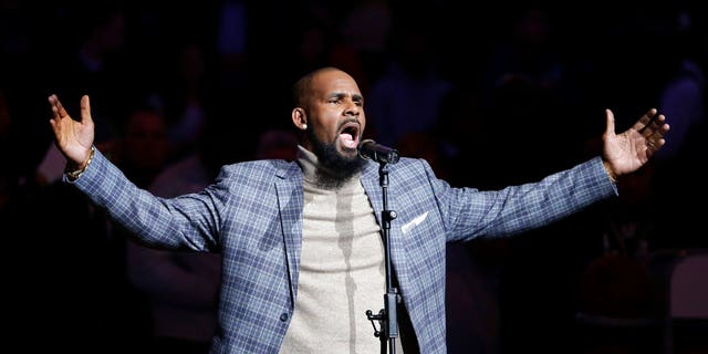 R. Kelly performs the national anthem at an NBA game in Brooklyn, N.Y., Nov. 17, 2015.