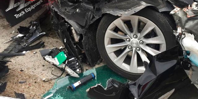 Sgt. Samuel Winkler said the car's air bags were activated and that the Tesla's 28-year-old driver suffered a broken right ankle, while the driver of the mechanic truck didn't require treatment.
