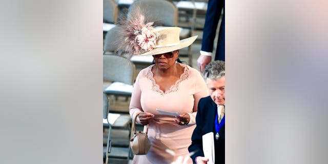 Oprah Winfrey arrives at St. George's Chapel at Windsor Castle for the wedding of Meghan Markle and Prince Harry.