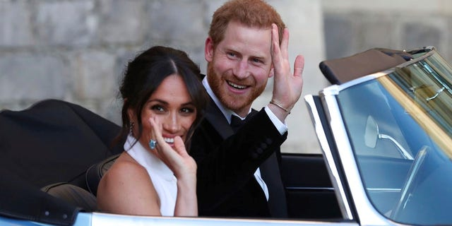 Prince Harry and Meghan Markle leave for the reception hosted by Prince Charles.