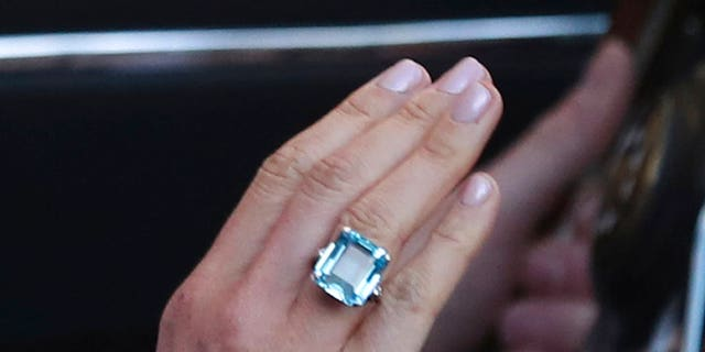 Meghan Markle wore Princess Diana's emerald-cut aquamarine ring to the wedding reception. (