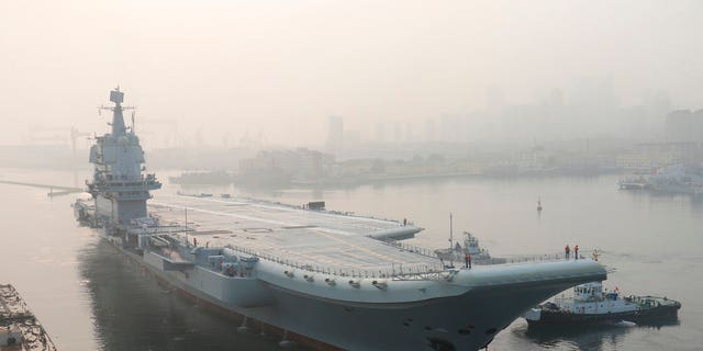 China's new unnamed home-built aircraft carrier leaves Dalian in northeast China's Liaoning Province for sea trials Sunday, May 13, 2018.