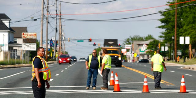 Officials guard a roadblock near a scene where a Baltimore County police officer died, while investigating a suspicious vehicle, Monday, May 21, 2018, in Perry Hall, Md.