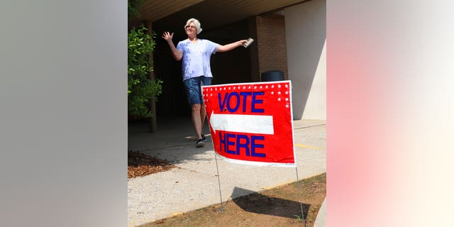 Cindy Benton celebrates after voting in the Arkansas primary election on Tuesday, May 22, 2018 in Little Rock, Ark. The Democratic and Republican parties held elections Tuesday, while all registered voters were allowed to vote in judicial elections.