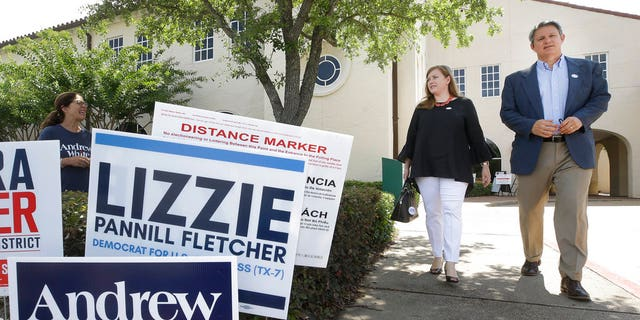 Lizzie Pannill Fletcher, a Democrat candidate for the 7th Congressional District, and her husband, Scott Fletcher, leave after voting in the primary runoff at St. Anne's Church, Tuesday, May 22, 2018, in Houston.