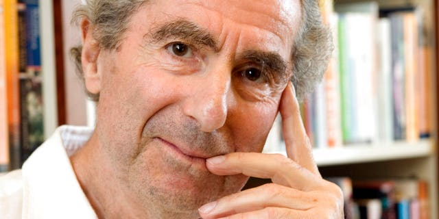 In this Sept. 8, 2008, file photo, author Philip Roth poses for a photo in the offices of his publisher, Houghton Mifflin, in New York.