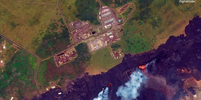 Satellite photo provided by DigitalGlobe shows lava coming out of fissures caused by Kilauea volcano, near Puna Geothermal Venture, a geothermal energy plant.