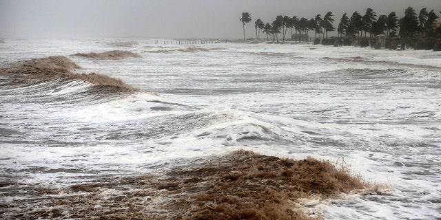 Cyclone Mekunu blew into the Arabian Peninsula on Saturday, drenching arid Oman and Yemen with rain, cutting off power lines, officials said.