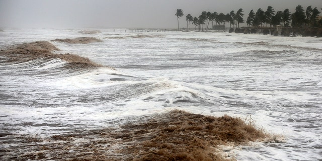 Cyclone Mekunu blew into the Arabian Peninsula on Saturday, drenching arid Oman and Yemen with rain, cutting off power lines, officials said.