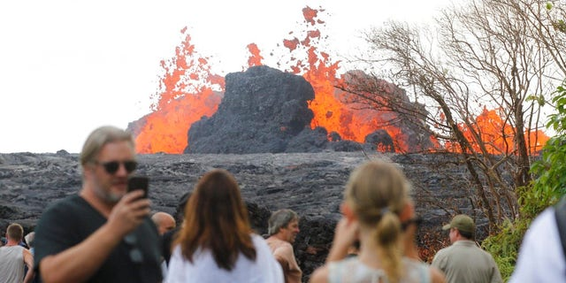 Residents, the media and national guard flock to what is now the end of Leilani Avenue to take in the fiery show at fissures 2, 7 and 8 of the Kilauea volcano near Pahoa.