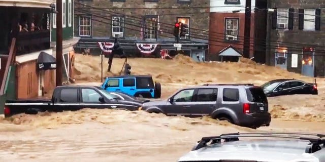 Flash flooding swept away cars in Ellicott City in Maryland on Sunday.
