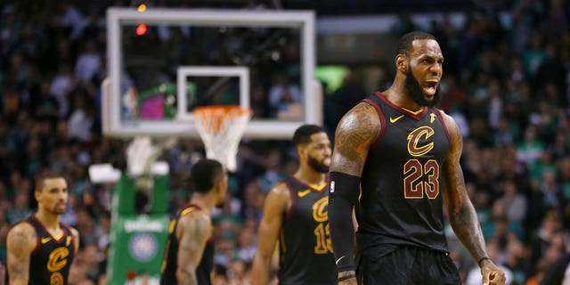 Cleveland Cavaliers forward LeBron James, right, celebrates a basket during the second half in Game 7 of the NBA basketball Eastern Conference finals against the Boston Celtics