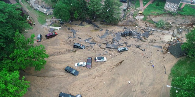 Several cars were seen destroyed and submerged in murky brown water after the flash flooding in Ellicott City.