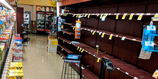 Supermarket shelves are stripped bare of bottled water in Salem, Ore., late Tuesday May 29, 2018, after officials warned residents that tap water was unsafe for children and the elderly due to an algae bloom.